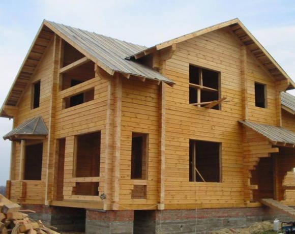 Дом из обрезного бруса на ленточном фундаменте